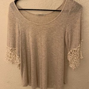 Flared lace sleeved top